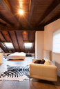 Interior beautiful loft luxurious bedroom Stock Image