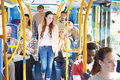 Interior of bus with passengers sitting down and getting off Royalty Free Stock Images