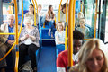 Interior of bus with passengers sitting down on seats Royalty Free Stock Images
