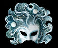 Interior and carnaval mask embodying the element of water, isolated on black background Royalty Free Stock Photo