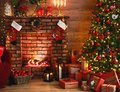 Interior christmas. magic glowing tree, fireplace, gifts in  dark Royalty Free Stock Photo