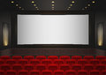 Interior of a cinema movie theatre. Red cinema or theater seats Royalty Free Stock Photo