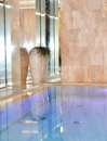 Interior clean water in blue swimming pool close up Royalty Free Stock Photo