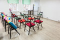 Interior of colorful room for business meeting with arranged chairs and flipchart. Office space Royalty Free Stock Photo
