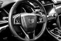 Interior of the compact car Honda Civic 1,5 Sport Plus, 2017. Black and white. Royalty Free Stock Photo