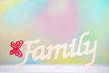 Interior decoration wooden letters closeup of detail handmade family sign on colorful background Stock Photo