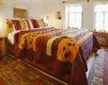 Interior design cave bedroom multi colored bedding Royalty Free Stock Photo