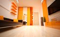 Interior design modern living room bright orange shades Stock Photo