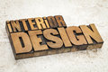 Interior design in wood type text vintage letterpress on a ceramic tile background Stock Photo