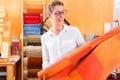 Interior Designer buying rug or carpeting Royalty Free Stock Photo