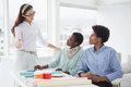 Interior designer speaking with clients Royalty Free Stock Photo