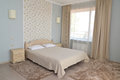 Interior of a double hotel room in light tones with a double bed Royalty Free Stock Photo