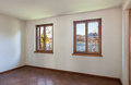 Interior empty room two windows architecture with terracotta floor Stock Photos