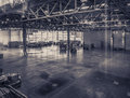 Interior of an empty warehouse with glass wall Royalty Free Stock Photo