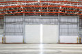 Interior of factory with shutter door day scene Stock Photos