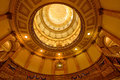 Interior of gold dome of colorado state capitol building a low angle view and its stair cases with holiday decorations in denver Stock Image