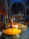Interior of Greek Orthodox Church With Lit Votive Candles Royalty Free Stock Photo