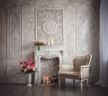 Interior with grey fretwork background fireplace and flowers Stock Photos