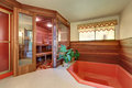 Interior of home wooden sauna cabin with jacuzzi bath Royalty Free Stock Photo