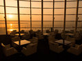 Interior of a hotel restaurant at sunset Stock Photos