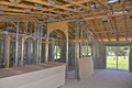 Interior of house under construction the a showing the framework and drywall waiting for mounting Royalty Free Stock Image