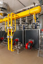 Interior of industrial gas boiler house with many pipes and boil Royalty Free Stock Photo