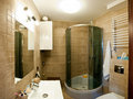 Interior of luxurious modern bathroom with shower cubicle in corner Stock Photography