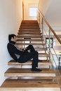 Interior, man sitting on the stairs Stock Image