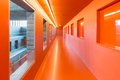 Interior modern building with several floors and orange painted passages open windows Stock Photo