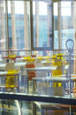 Interior of modern company lunchroom behind window big Royalty Free Stock Photography