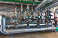 The interior of a modern gas boiler house with pumps, valves, a Royalty Free Stock Photo
