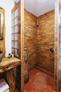 Interior of a modern wooden shower cabin Royalty Free Stock Photo