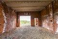 Interior of an old building under construction. Orange brick wal Royalty Free Stock Photo