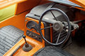 Interior of old classic car with steering wheel and dashboard vintage Stock Image