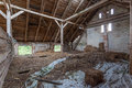 Interior of an old decaying barn built wood and brick abandoned Royalty Free Stock Photo