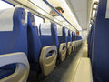 Interior of a passenger train with empty seats Royalty Free Stock Photos