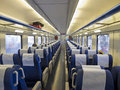Interior of a passenger train with empty seats Stock Photo