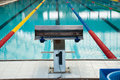 Interior of public indoor swimming pool with racing Lanes and bl Royalty Free Stock Photo