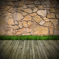 Interior room with stone wall brown grunge green grass on wood floor Stock Photo