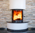 An interior shot of a modern marble fireplace Royalty Free Stock Photo