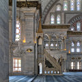 Interior shot of Nuruosmaniye Mosque with minbar platform, arches & colored stained glass windows, Istanbul, Turkey Royalty Free Stock Photo