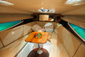 Interior small luxury boat leather seat table hi fi sound system Stock Photo