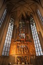 Interior of St. James Church in Rothenburg Ob der Tauber, wooden behind the altar the image of the ` Holy Blood`. Bavaria,