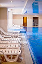 Interior of swimming pool with deck chair Royalty Free Stock Image