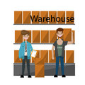 Interior of warehouse.Two worker front shelves