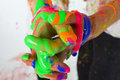 Interlocked Fingers with Colorful Paint Stock Photography