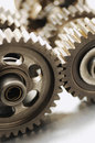Interlocking gears cogwheels selective focus Stock Images