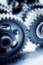 Interlocking gears cogwheels selective focus Stock Photos