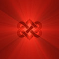 Interlocking heart knot shine light flare red symbol illustrated with powerful flares metaphor for forever love wedding engagement Royalty Free Stock Photo