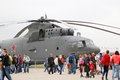 International aerospace salon maks people walk by a grey helicopter at taken on august in zhukovsky moscow region russia Royalty Free Stock Images